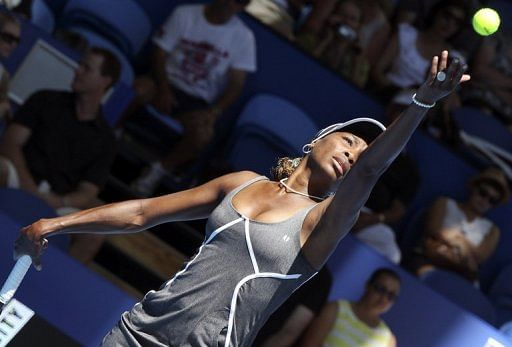 Venus Williams serves during a women