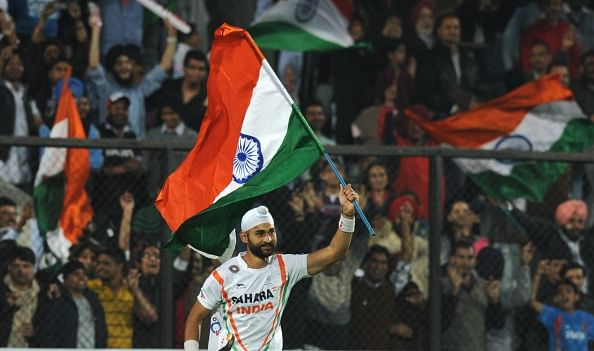 Sandeep Singh of India waves the Indian