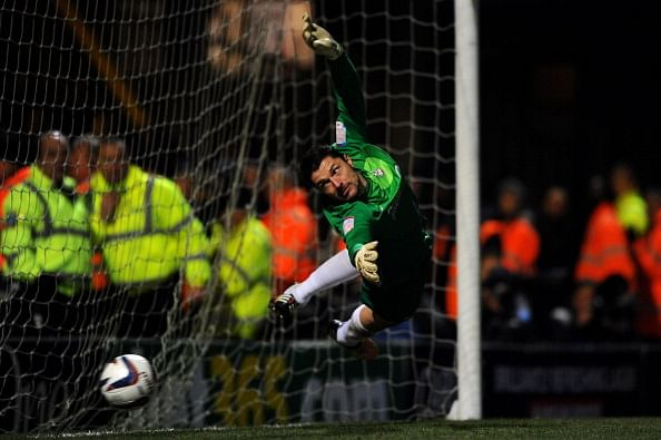 BRADFORD, ENGLAND - DECEMBER 11:  Goalkeeper Matt Duke of Bradford in action in the penalty shootout during the Capital One Cup quarter final match between Bradford City and Arsenal at the Coral Windows Stadium, Valley Parade on December 11, 2012 in Bradford, England.  )