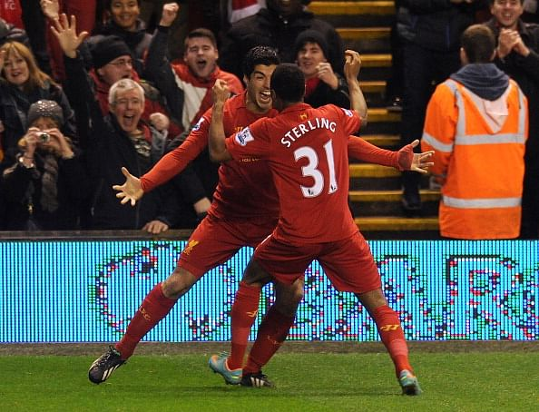 LIVERPOOL, ENGLAND - JANUARY 02:  (THE SUN OUT, THE SUN ON SUNDAY OUT) Raheem Sterling of Liverpool celebrates his goal with Luis Susrez to make it 1-0 during the Barclays Premier League match between Liverpool and Sunderland at Anfield on January 2, 2013 in Liverpool, England.