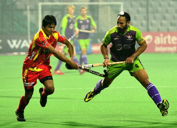 NEW DELHI, INDIA - JANUARY 30: A match in progress between Ranchi Rhinos against Delhi Waveriders during the Hockey India League match in New Delhi on Wednesday.
