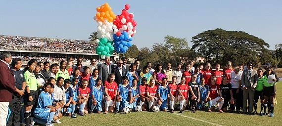 The Indian Team and the Dutch team pose for a photograph with the officials before kickoff.