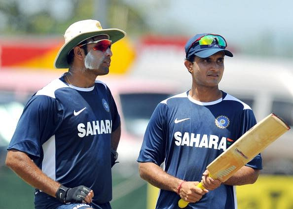 Indian cricketer V.V.S. Laxman (L) speak
