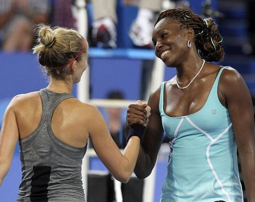 Venus Williams of the US (R) and Mathilde Johansson of France (L) after their match in Perth on January 1, 2013