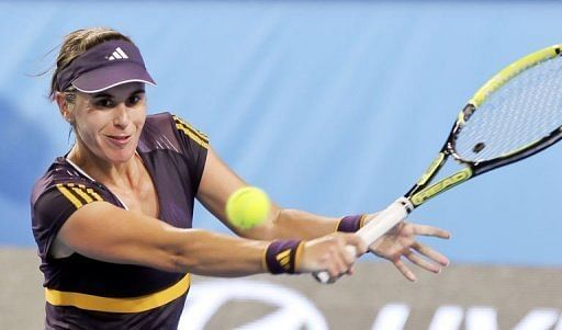 Anabel Medina Garrigues of Spain hits a return in Perth on January 5, 2013