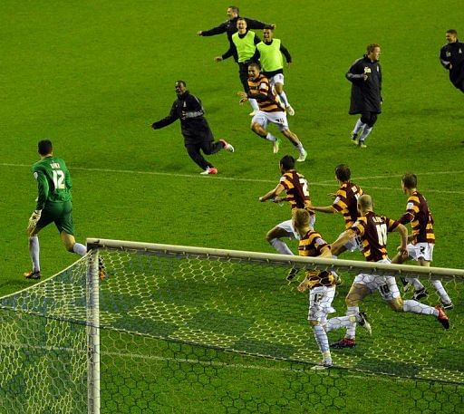 Bradford City celebrate winning the penalty shoot-out against Wigan in the League Cup fourth round on October 30, 2012