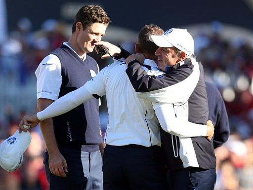 Sergio Garcia, Justin Rose and Paul McGinley of Europe celebrate at the Ryder Cup at Medinah on September 30, 2012