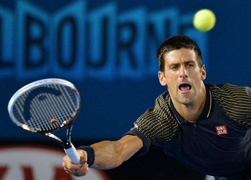 Novak Djokovic plays a return during his match against Ryan Harrison of the US in Melbourne on January 16, 2013