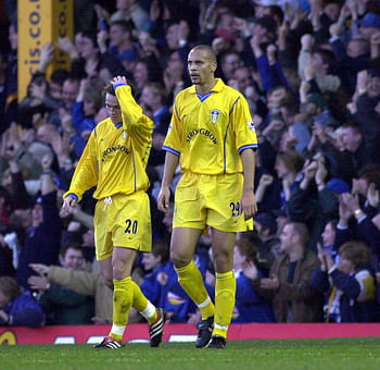 Ferdinand looked out of sorts against Leicester in 2000;seen here with teammate Matthew Jones