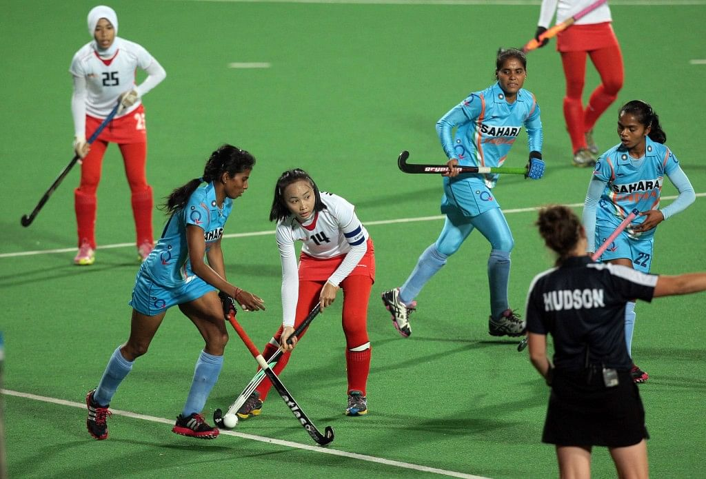 Hero Hockey World League 2013 Yendala Soundarya of India in action against Abdul Rahman Nadia of Malaysia at Delhi on 19th Feb 2013.