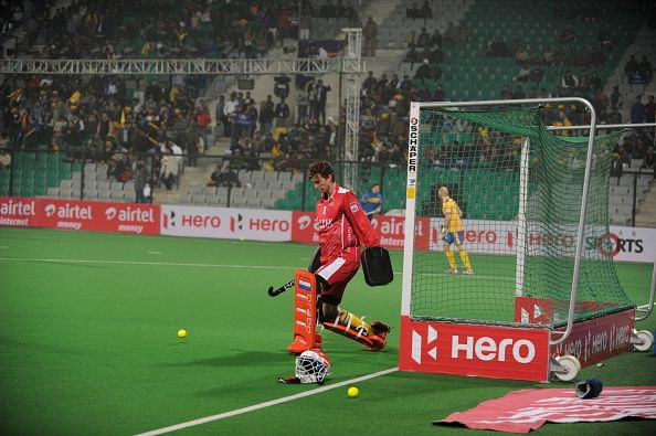 Dutch hockey goalkeeper Jaap Stockmann, playing for Punjab Warriors, warms up on the field prior to the inaugural match of the Hockey India League (HIL) between Punjab Warriors and Delhi Waveriders in New Delhi on January 14, 2013.