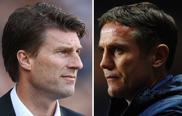 Swansea manager Michael Laudrup (L) and Bradford manager Phil Parkinson.