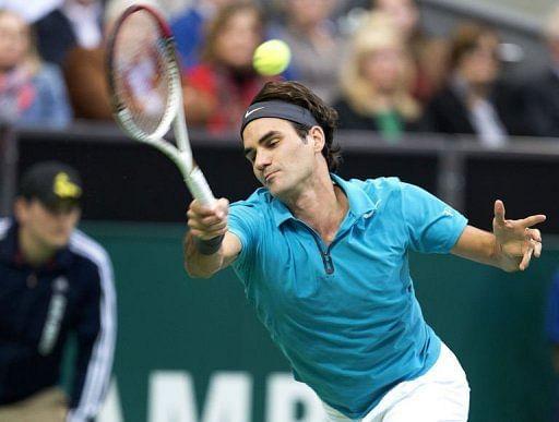 Swiss player Roger Federer returns a ball to France
