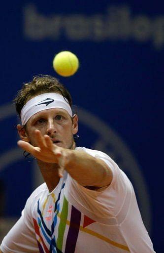 Argentinian tennis player David Nalbandian eyes the ball in Sao Paulo, Brazil, on February 16, 2013