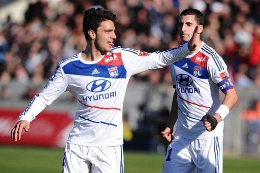 Clement Grenier (L) celebrates after scoring a goal against Bordeaux on February 17, 2013