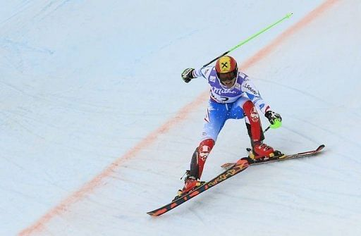 Marcel Hirscher crosses the finish line to take gold in the men