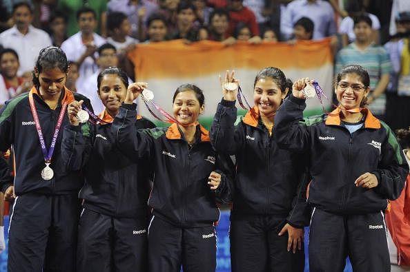 (L-R) Silver medalists Shamini Kumaresan, Mouma Das, Poulomi Ghatak, Prabhu Mamta and Madhurika Suhas Patkar of India show their medals at the table tennis women