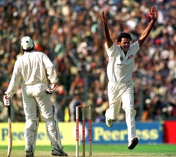 Indian pace bowler Javagal Srinath (R) celebrates