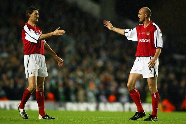 Tony Adams of Arsenal with former team-mate Steve Bould