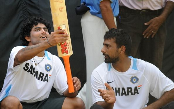 Indian cricketer Ravindra Jadeja (L) and