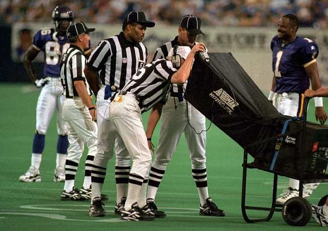 Officials gather to review a play during a National Football League game using the sideline review booth. Instant Replay has been implemented by the NFL in some form since the 1986 season, and has proved to be very successful