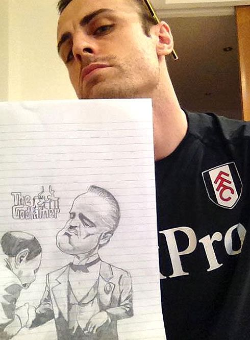 "Berba posing with his ""Godfather"" caricature"