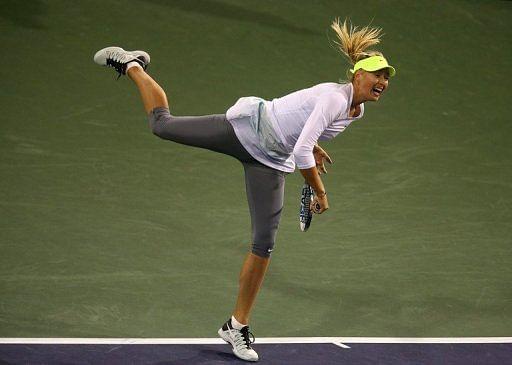 Maria Sharapova serves to Francesca Schiavone on March 8, 2013