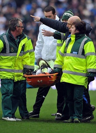 Massadio Haidara is stretchered off the pitch in Wigan on March 17, 2013