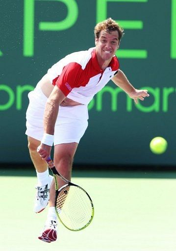 Richard Gasquet of France returns a shot to Oliver Rochus of Belguim, March 23, 2013 in Key Biscayne, Florida