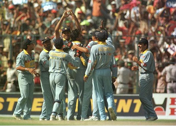 Javagal Srinath of India is congratulated by teammates after taking the wicket of Jayasuriya during the semifinal of the Cricket World Cup played at Eden Gardens. (Getty Images)
