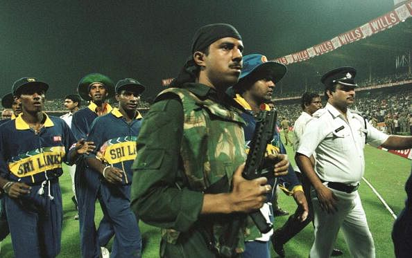 Riot police lead the Sri Lankan team off the pitch after the abandonment of the semifinal in the World Cup against India  played at Eden Gardens. (Getty Images)