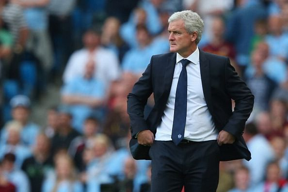 MANCHESTER, ENGLAND - SEPTEMBER 01:  Mark Hughes the manager of Queens Park Rangers looks on during the Barclays Premier League match between Manchester City and Queens Park Rangers at Etihad Stadium on September 1, 2012 in Manchester, England.  (Photo by Alex Livesey/Getty Images)