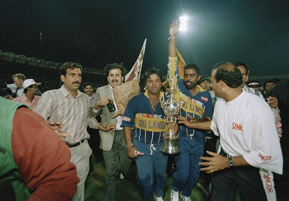 Sri Lankan captain Arjuna Ranatunga (left) and teammate Asanka Gurusinha leave the pitch with the trophy after the semi- final of the Cricket World Cup against India at Eden Gardens, Calcutta, India, 13th March 1996. Sri Lanka were awarded the match after play was halted by rioting among spectators. (Photo by Ross Kinnaird/Getty Images)