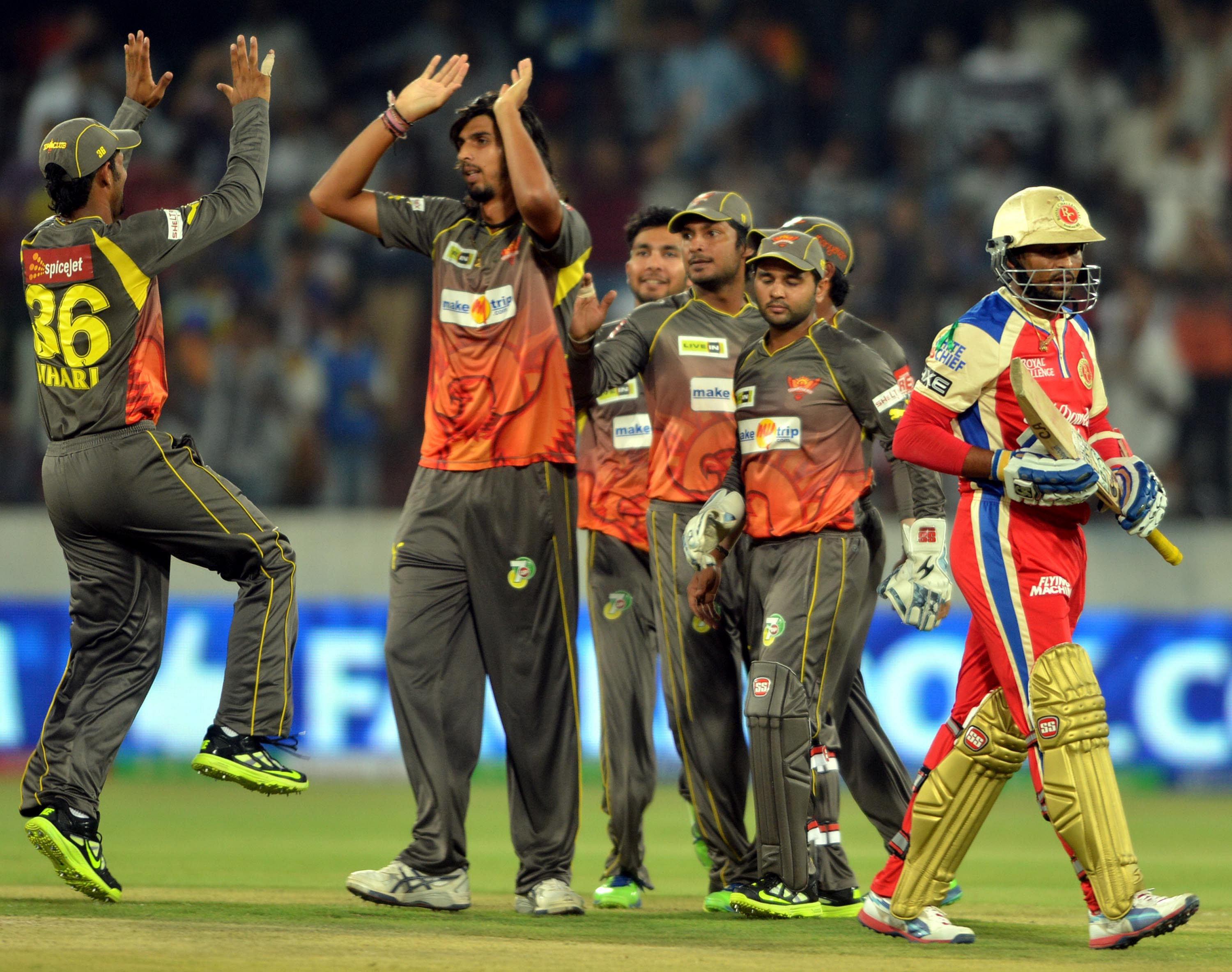 Sunrisers Hyderabad player celebrate as Royal Challenger Bangalore player TM Dilshan walks back to the pavilion during the match between Royal Challengers Bangalore and Sunrisers Hyderabad at Hyderabad on April 7, 2013. (Phoo: IANS)