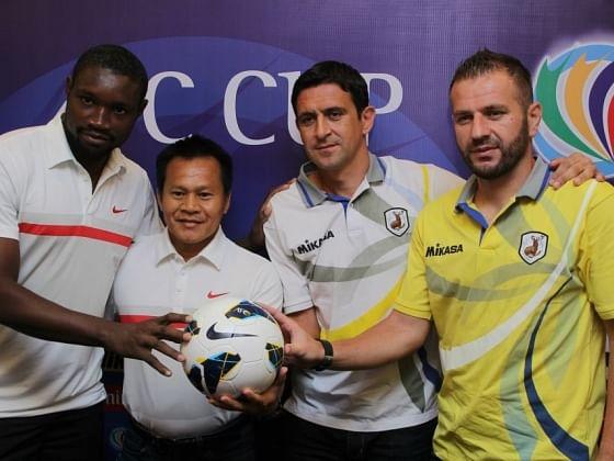Amougou (far left)