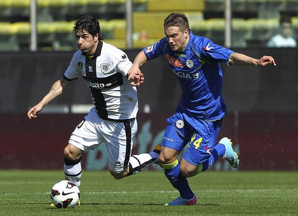 Jaime Valdes (L) of Parma FC competes for the ball with Antonio Piotr Zielinski of Udinese.