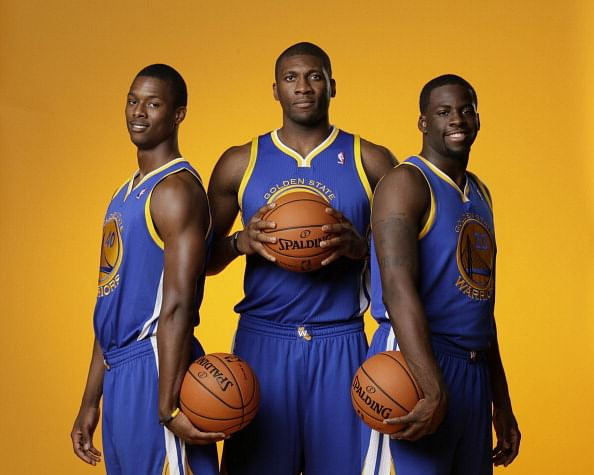 : Harrison Barnes #40, Festus Ezeli  #31 and Draymond Green #23 of the Golden State Warriors poses for a portrait during the 2012 NBA rookie photo shoot on August 21, 2012 at the MSG Training Facility in Tarrytown, New York. NOTE TO USER: User expressly acknowledges and agrees that, by downloading and or using this photograph, User is consenting to the terms and conditions of the Getty Images License Agreement. Mandatory Copyright Notice: Copyright 2012 NBAE (Photo by Steven Freeman/NBAE via Getty Images)