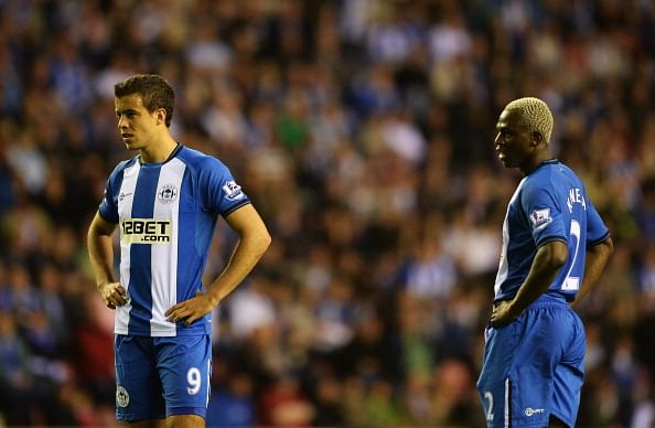 Franco Di Santo (9) and Arouna Kone of Wigan Athletic look dejected during the Barclays Premier League match between Wigan Athletic and Swansea City at DW Stadium on May 7, 2013 in Wigan, England.  (Photo by Laurence Griffiths/Getty Images)