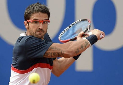 Serbian Janko Tipsarevic returns the ball in Munich, southern Germany, on May 2, 2013