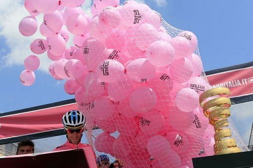 Vincenzo Nibali stands as ballons are released on May 14, 2013 in Altopiano del Montasio