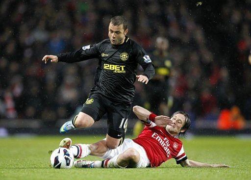 Arsenal midfielder Tomas Rosicky (R) challenges Wigan