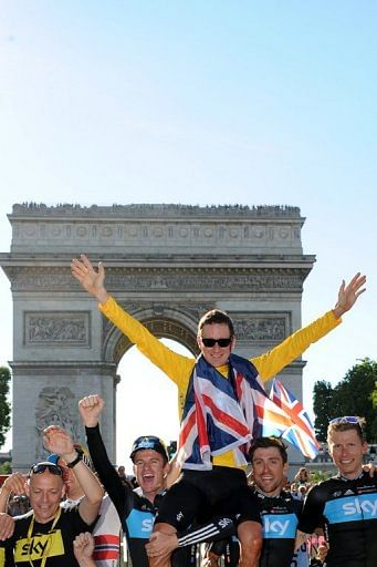 Bradley Wiggins celebrates on the Champs Elysees in Paris on July 22, 2012 after winning the Tour de France