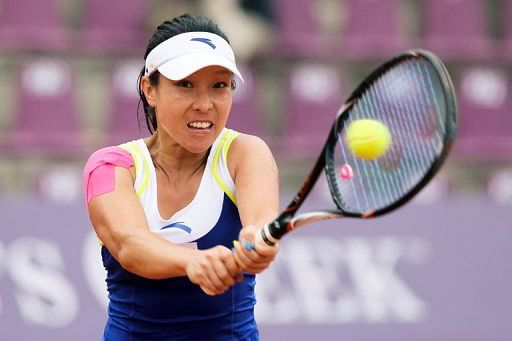 Chinese player Zheng Jie returns a ball to Caroline Wozniacki in Brussels, on May 22, 2013