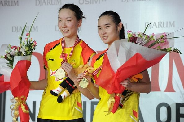 Chinese women double team Cheng Shu (L) and Bao Yixin (R) display their gold medals during the award ceremony after defeating Chinese compatriots Wang Xiaoli and Yu Yang during the Djarum Indonesia Open 2013 women doubles final at Senayan sport center in Jakarta on June 16, 2013.  Cheng and Bao won 21-15, 18-21, 18-21 to bag the gold medal.     AFP PHOTO / ROMEO GACAD        (Photo credit should read ROMEO GACAD/AFP/Getty Images)