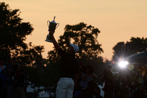 Justin Rose of England celebrates with the U.S. Open trophy after winning the 113th U.S. Open at Merion Golf Club on June 16, 2013 in Ardmore, Pennsylvania.  (Photo by Ross Kinnaird/Getty Images)