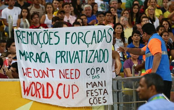 Protestors display banners during the FIFA Confederations Cup Brazil 2013 Group B match between Spain and Tahiti at the Maracana Stadium on June 20, 2013 in Rio de Janeiro, Brazil.  (Getty Images)