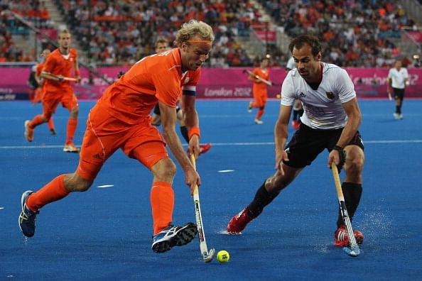 Christopher Zeller of Germany challenges Floris Evers of Netherlands during the Men
