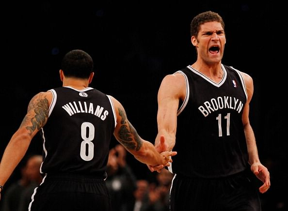 Brook Lopez #11 and Deron Williams #8 along with KG, Pierce and Joe Johnson will make up the starting five for the Nets. (Getty Images)