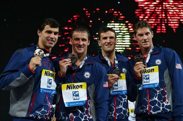 Gold medal winners Conor Dwyer, Ryan Lochte, Charlie Houchin and Ricky Berens of the USA celebrate on the podium after the Men