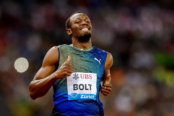 Usain Bolt, all smiles after winning the 100m